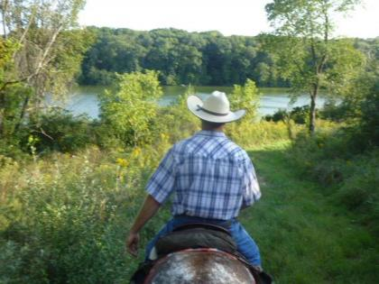 Horseback rider looking out over Lake Carlton at Morrison-Rockwood State Park
