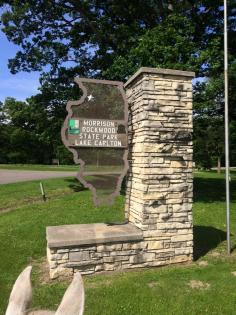 The view of the Morrison-Rockwood State Park metal Illinois sign framed by horse ears.
