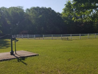 Equestrian trailhead with arena and water pump at Roland Olson Forest Preserve in Roscoe, IL